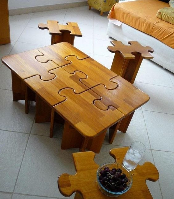 Puzzle shaped table and stools