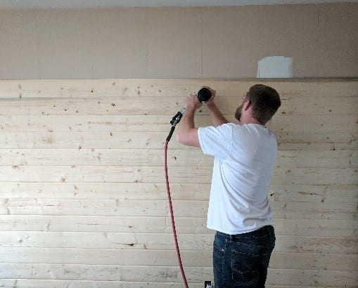 Step 2 Start Placing The Wood Planks By Nailing Them To The Wall