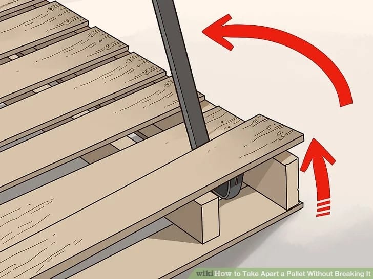 Taking Apart A Wood Pallet Using A Pry Bar Step 1 1