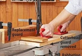 A Power Jointer Removes Wood From The Lower Face