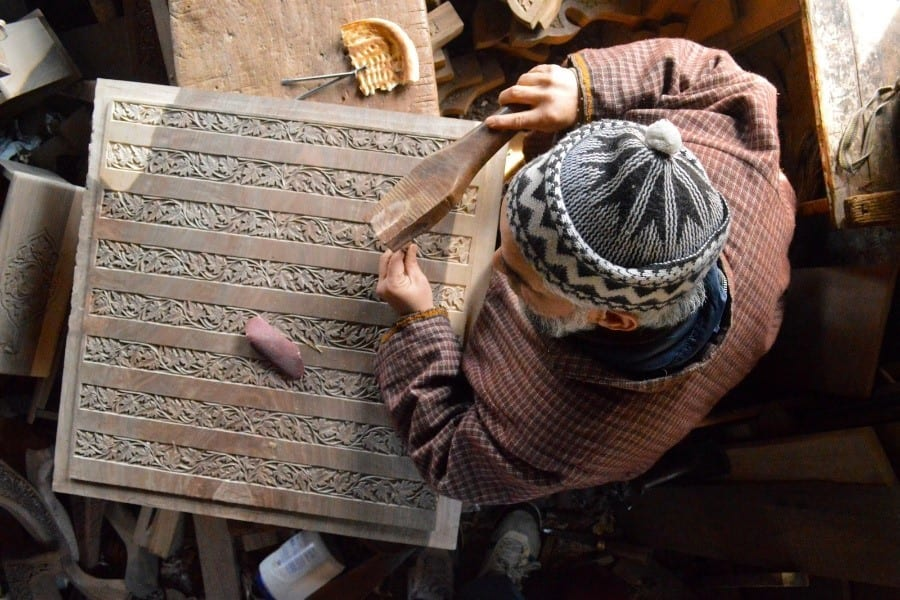 A Local Artisan In The Process Of Walnut Wood Carving In Kashmir