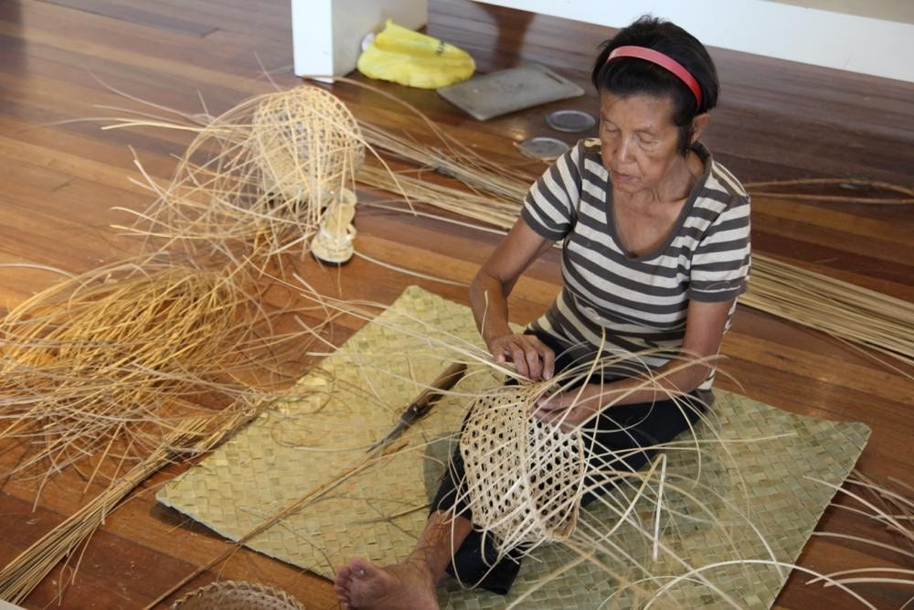 A Mat And Basket Weaver Takes Part In Hands On Demonstrations