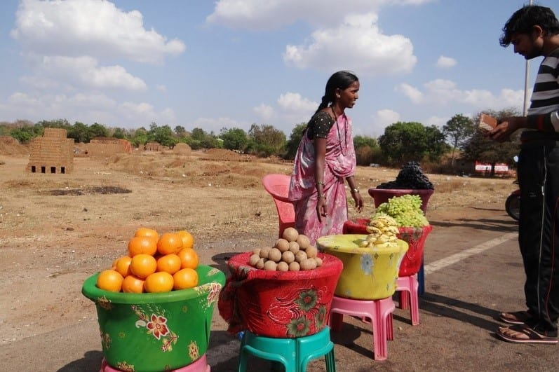 A Young Girl Selling Fruits On The Roadsides Of India