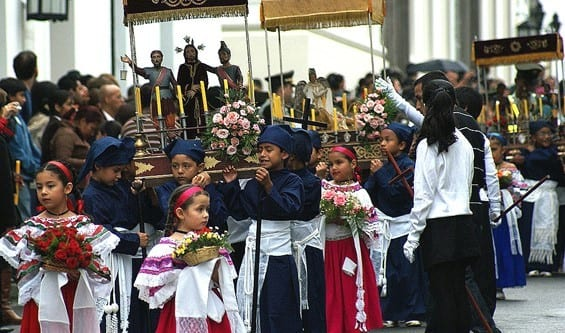 Carrying The Sacred Symbols Of Faith Down The Streets Of Popayan