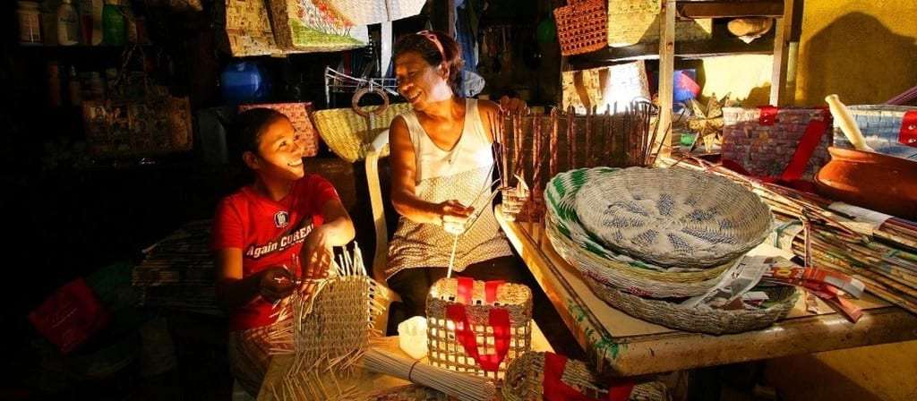Filipino Family Working On Traditional Handicrafts Up Late In The Evening