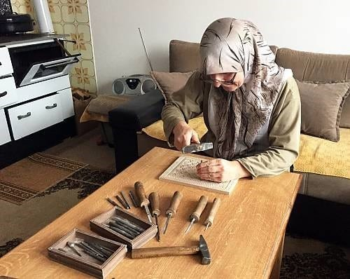 Local Woman Engaged In The Craft Of Konjic Woodcarving At Home